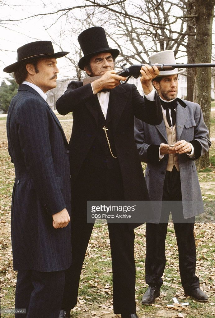 Abraham Lincoln (Gregory Peck)  tests a Spencer repeating rifle in the movie The Blue and the Gray.