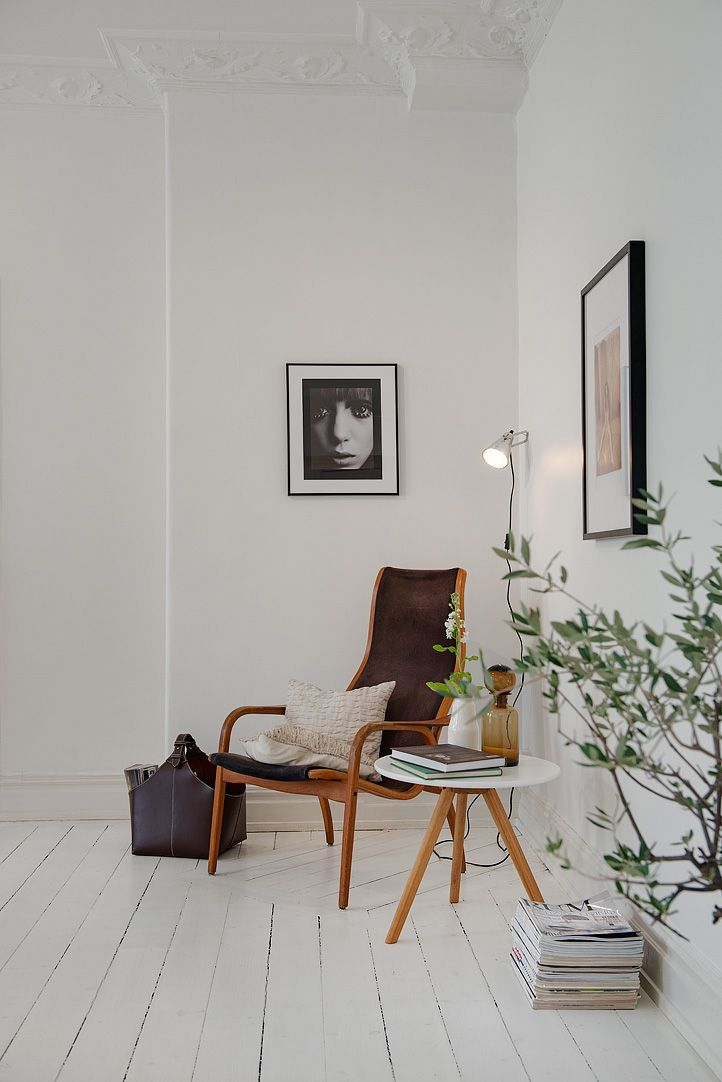 scandinavian corner, white floor boards