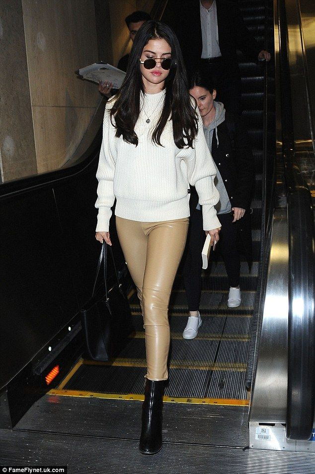Selena Gomez stuns in skintight nude trousers as she arrives at LAX | Daily Mail Online