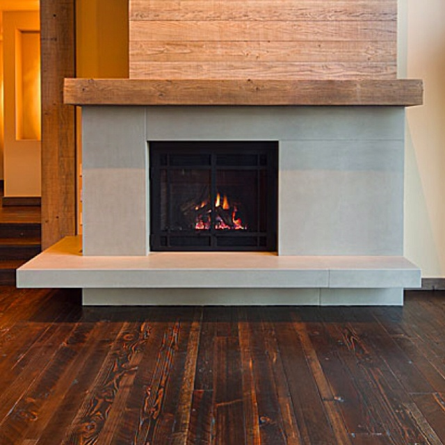 Clastic designs fireplace surround like lifted hearth for Concrete mantels and hearths