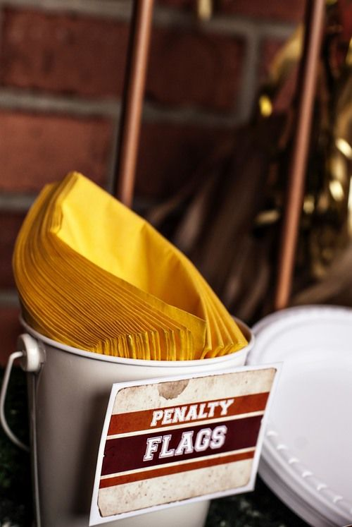 "Yellow napkins labeled ""Penalty Flags"" - so simple but cute!"
