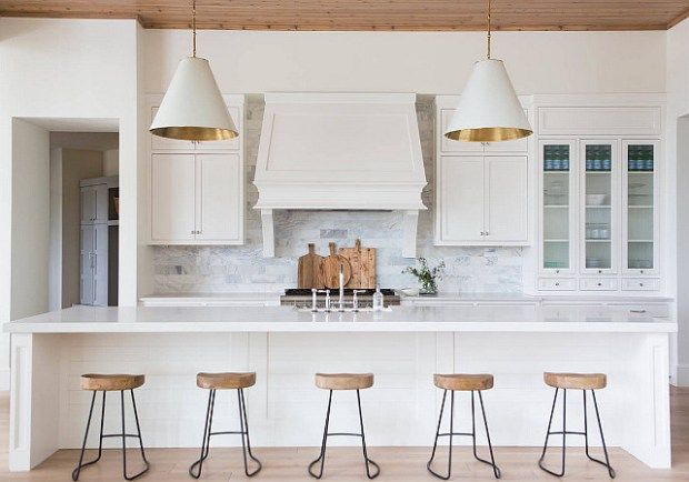 Transitional Style White Kitchen Mixed and Matched Hardware Quartz Countertops Barstools Pendant Lighting Kitchen Sink Gallery Wall