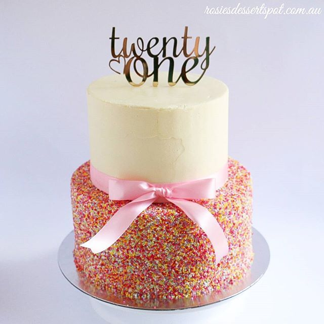 Our easy two tier sprinkles cake topped with our custom 21st birthday topper…