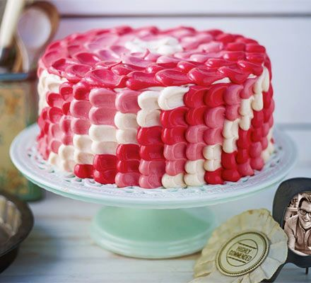 Edd Kimber's Bakewell Ombre Cake: Inspired by the classic Bakewell tart, the raspberry jam and almond flavours of this sandwich sponge complement the stunning pink graduated frosting.