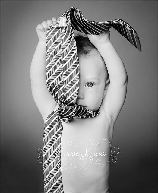 Find a prop, let them dress up and take photos, would be cute with the tie, but can use hats that are too big for them, or Daddy's shoes!