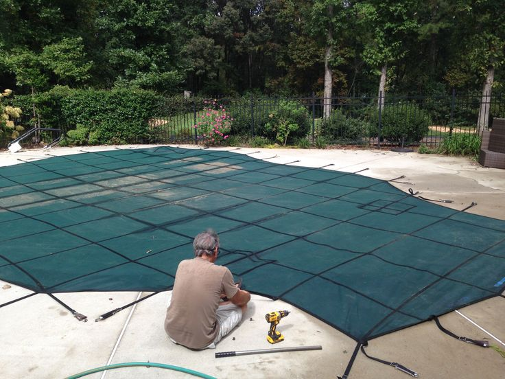 """Installing an inground swimming pool cover requires that the anchors that are flat in the summer need to be drilled """"up"""" for the straps to attach to."""