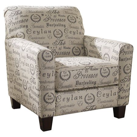 Tea featuring french script upholstery and brown block legs this eye catching arm chair for Naomi in the living room script