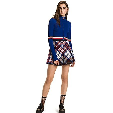 Tommy Hilfiger women's skirt. As seen on the runway, the schoolgirl staple is elevated in wool, mohair and silk. Tailored in a flirty A-line shape for a universally-flattering fit. A limited-edition, Hilfiger Collection piece. <br>• Slim fit, above knee length.<br>• 60% wool, 26% polyacrylic, 14% silk. <br>• A-line, contrast waistband.<br>• Dry clean.<br>• Imported.