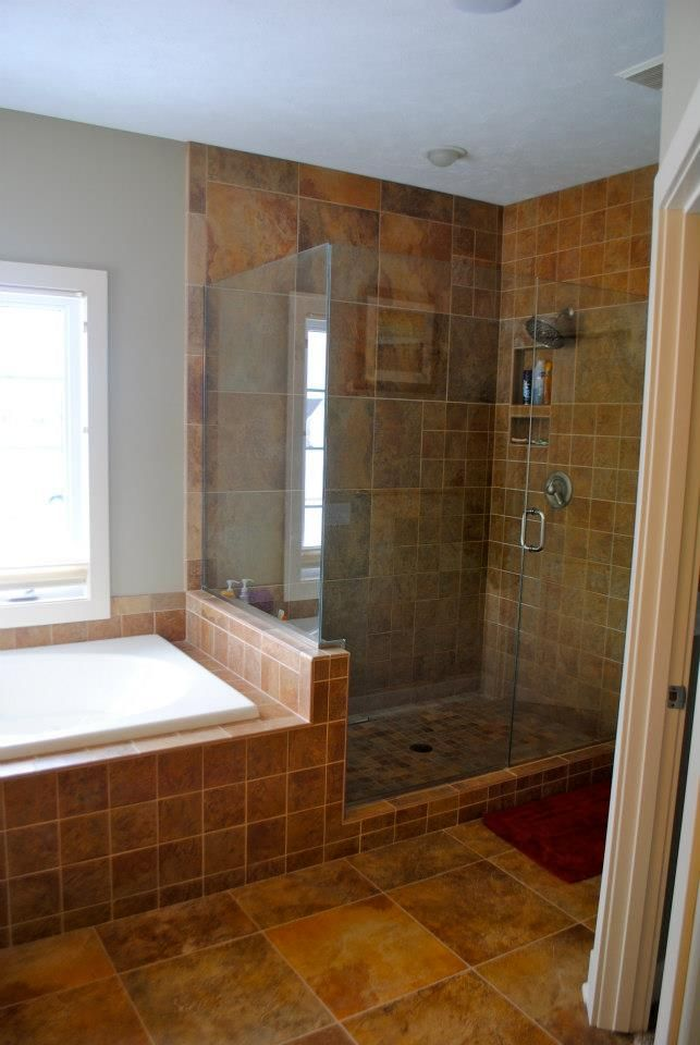 Beautiful built in large soaking bathtub next to custom for Custom tubs and showers