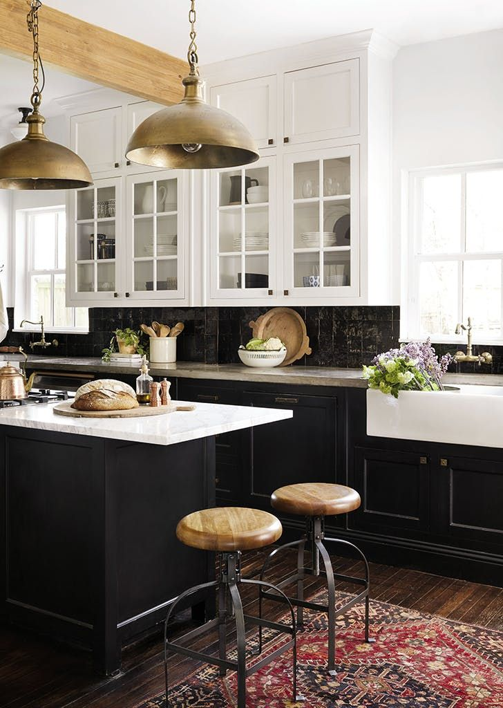 Two Toned Cabinetry With White Countertops Makes A Good Statement Here Joanna Gaines Black Kitchen Joanna Gaines Kitchen Kitchen Design Home Kitchens