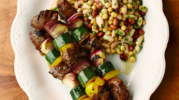 Marinated meat skewers with a three-bean salad