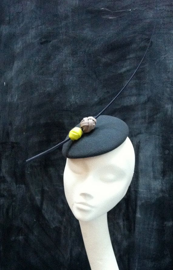 Hand made charcoal grey felt cocktail hat with acid yellow and beige trim. Chic, contemporary and fab for weddings or races.  www.fifilabelle.com