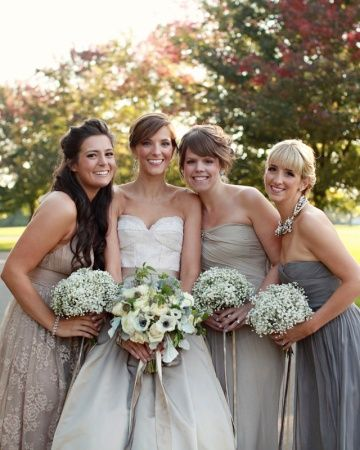 Bouquets of baby's breath unified these bridesmaids, who wore dresses in neutral