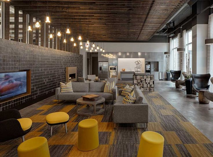 24-hour lounge with fireplace, TVs, billiards and foosball table at AMLI Lofts, luxury South Loop apartments in Chicago.