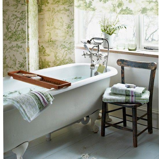 Green toile bathroom with roll-top bath