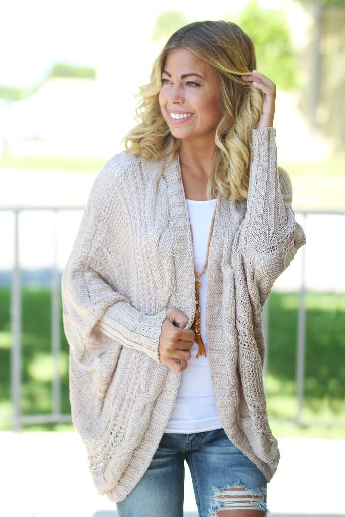 CUTE AND COZY! Get all snuggled up in this adorable Taupe Knit Open Cardigan! This is the perfect cardigan for those chilly nights! Don't miss out on this comfortable cutie! - 55% cotton - 30% acrylic