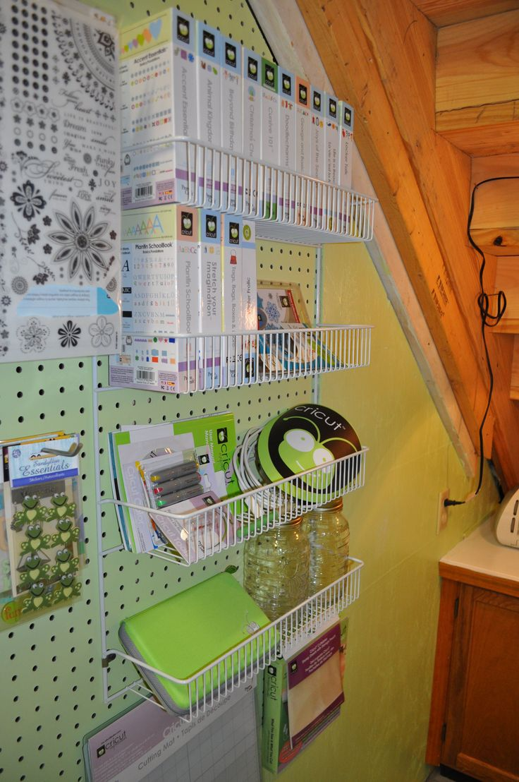 Description: This rack originally held rolls of ribbon but when I discovered the cricket cartridges fit perfectly I knew this would add nicely to my 'cricket corner'. I don't use my cricket as much as I should but now my machine and accessories are next to each other and I don't have to go searching through a container to find what I am looking for