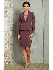 Деловой юбочный костюм темно-зеленого цвета. Жакет выполнен из комбинации джерси и костюмной ткани, что обеспечивает комфорт в носке и хорошую посадку по фигуре. Юбка прямая, на подкладке. Элегантный вариант для офисного гардероба.