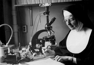 Sister Mary Gerald Leahy taking notes, Mount St. Mary's College, 1967.