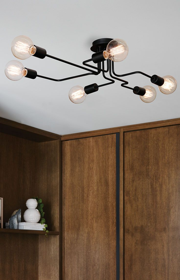 The Beacon Lighting Pac 6 light close to ceiling pendant in black.