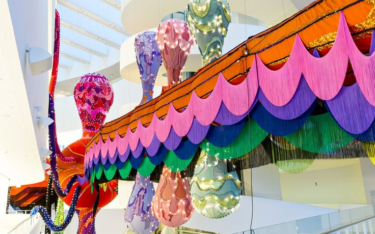 For her solo exhibition Textures of Life at ARoS, Portuguese artist Joana Vasconcelos has created the elaborate site specific installation piece Valkyrie Rán, made out of 2100 meters of Kvadrat textile across 549 colours and designs. The 50 meter long piece will meander the entire main hall and atrium of the museum from entrance to back and across all eight levels in height.A large part of installation artist Joana Vasconcelos' work revolves around the feminine – both as a social and a ...