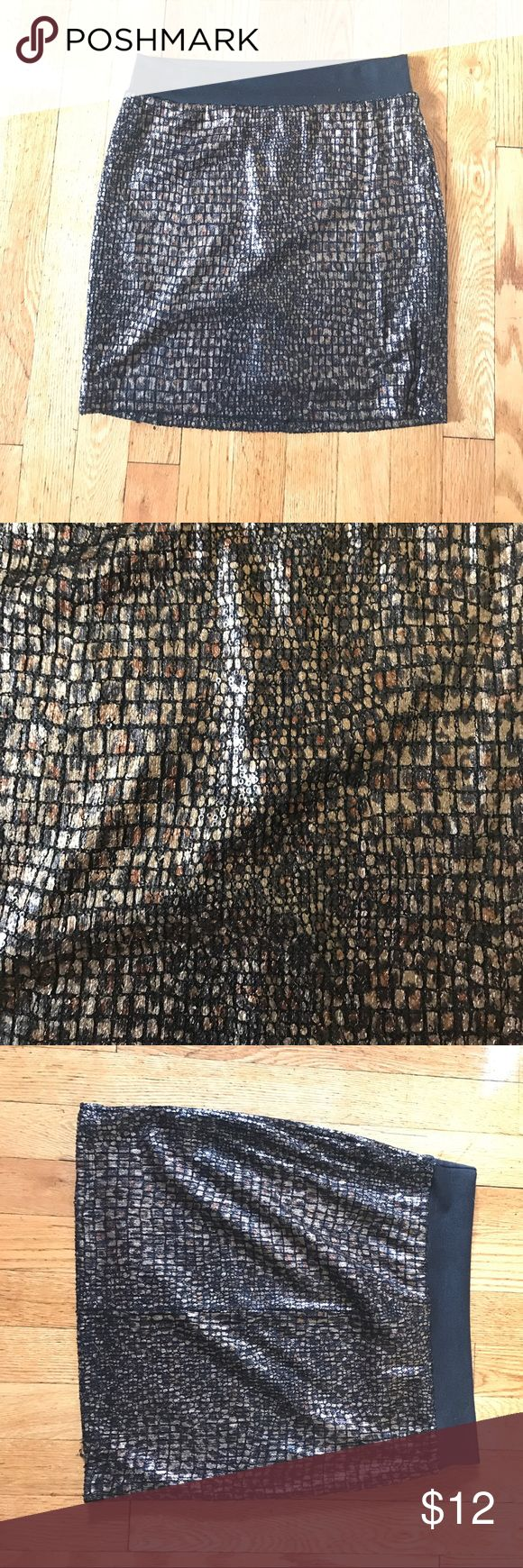 Honey Punch leopard sequined skirt Only worn once! Skirt is fun for a night out! Skirt has some stretch and band at the top. 100% polyester, approx 16 inches long. Honey Punch Skirts Mini