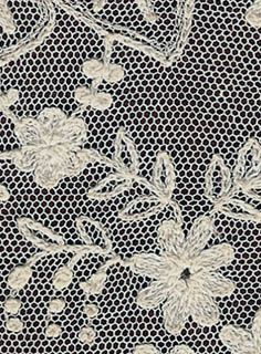 TUL BRODAT  Close-up of Tambour Lace, the netting appears machine made.