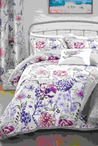 Boasting a stunning pink and purple floral print, we wouldn't mind drifting off into this bed this evening.