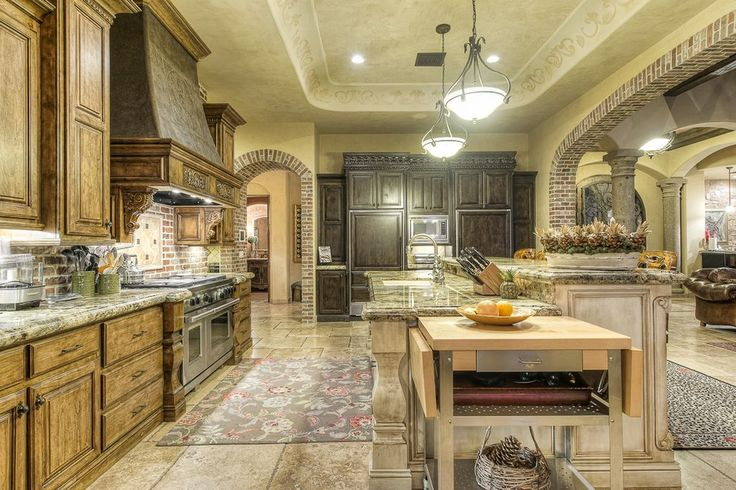 Mediterranean Kitchen with Pendant Light, limestone tile floors, Breakfast bar, High ceiling, Complex granite counters