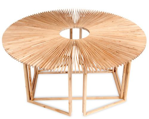 """""""The FAN Table by Mauricio Affonso easily transforms shapes and sizes with its innovative design. The tabletop is made from more than 400 connected slats that expand and contract to create the shape you need, while the simple, geometric base that it sits on is constructed of birch wood.""""Coffe Tables, Design Products, Change Shape, Mauricioaffonso, Fans Tables, Design Mauricio, Mauricio Affonso, Products Design, Furniture"""