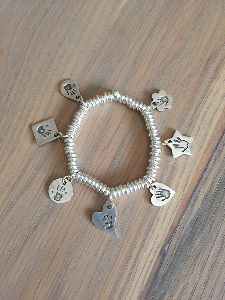 Handprints done of all the children and grandchildren into sterling silver charms on a sweetie bracelet by Smallprint. www.smallprint.co.za - the perfect gift <3