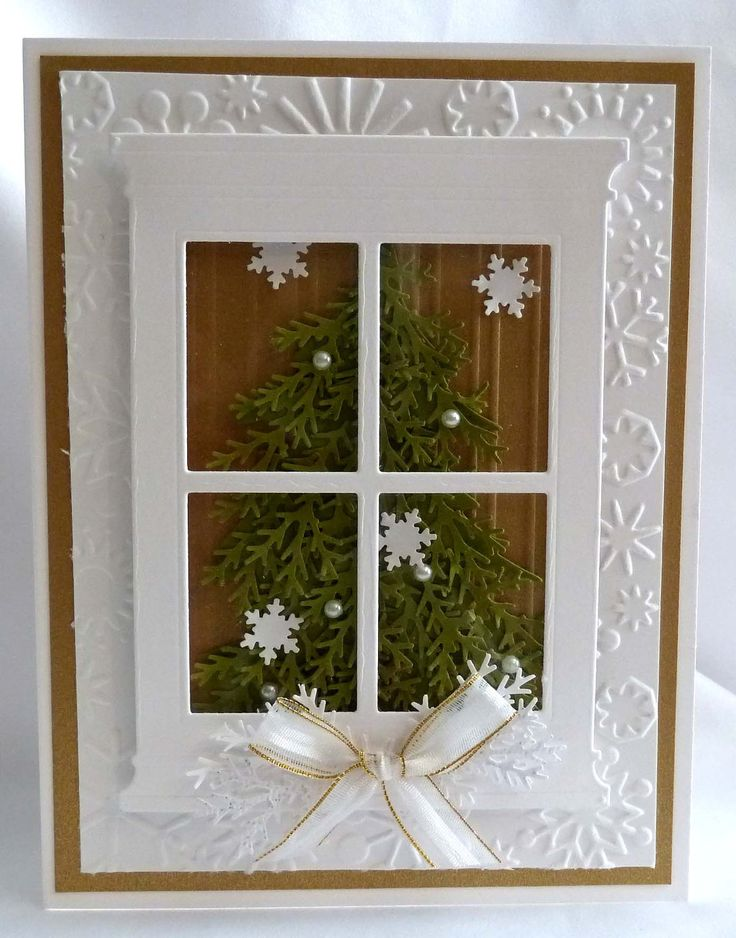 """The background layer are embossed with snowflakes. The window has a clear piece of acetate behind it to make it look like a realistic window"""