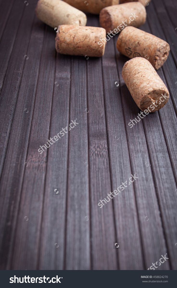 A Few Corks On Dark Wooden Table Stock Photo 458824270 : Shutterstock