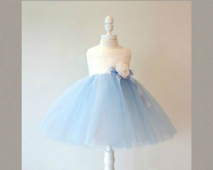 White - Blue Tulle Flower Girl. Light blue tutu dress. This Adorable dress is simply better made and sewn properly.  They're more comfortable and they make your little girl look fabulous. Available from 3 month until 12 years old  Material: Polyester fiber, Purified cotton lining, tulle mesh, satin. Free shipping.