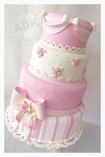 cake, like the simple rose trims, and the stripe base. would be lovely as individual cakes