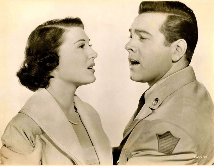 """Doretta Morrow and Mario Lanza in a promotional photo for Alexander Hall's """"Because You're Mine"""" (1952)."""