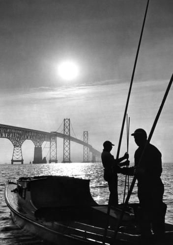 Oyster Tongers, 1965: Hand-tonging for oysters from the slippery deck of a bobbing boat is probably the toughest job there is in the Bay country. These watermen are working south of the Chesapeake Bay Bridge.