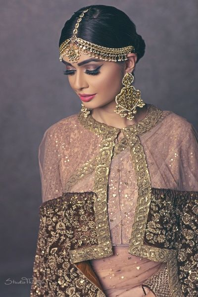 Indian Wedding Jewelry - Polki and Gold Jewelry | WedMeGood | Gold, Polki and Pearl Maatha Patti with Jhumkas and a Sheer Net Pink and Wine Cape with Gold Embroidery, Purple Smoky Eye Makeup with Pink Lips #wedmegood #indianjewelry #indianwedding #indianbride #cape #gold #bridal