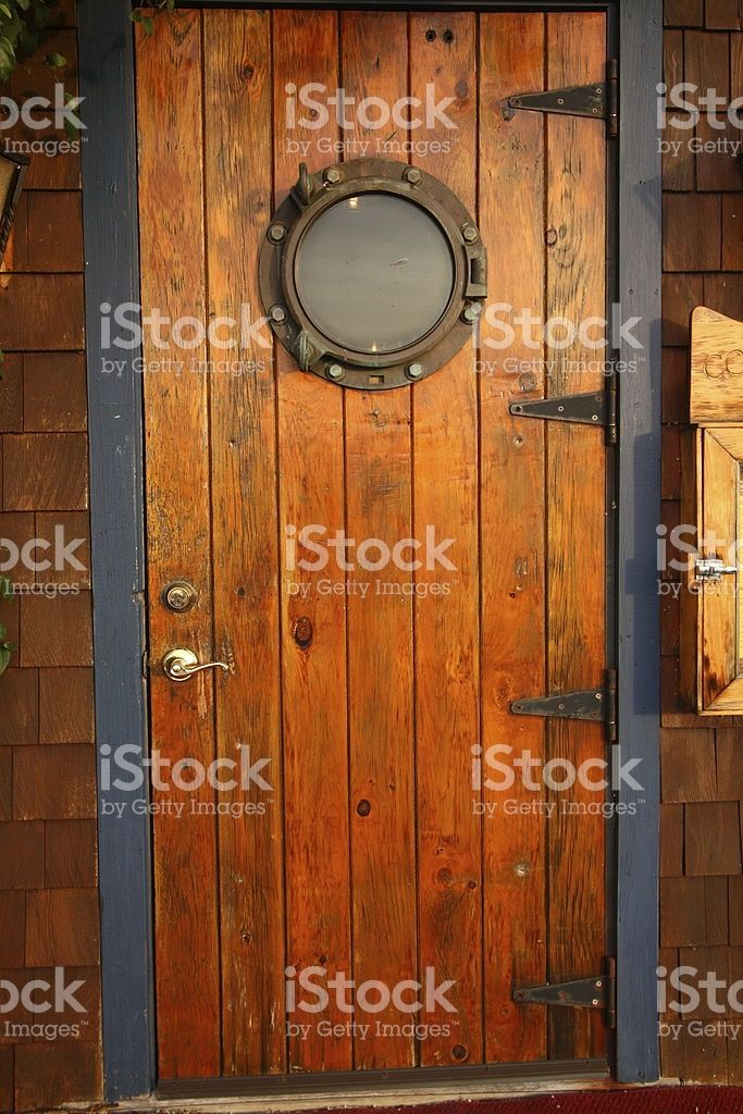 The Door To A Restaurant Featuring A Port Hole Wooden Doors Wood Doors Interior Doors Interior