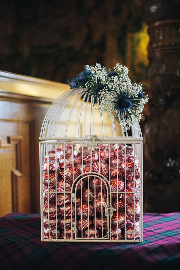 Tunnocks tea cakes in a birdcage - a fun wedding cake alternative. http://www.lisadevinephotography.co.uk/