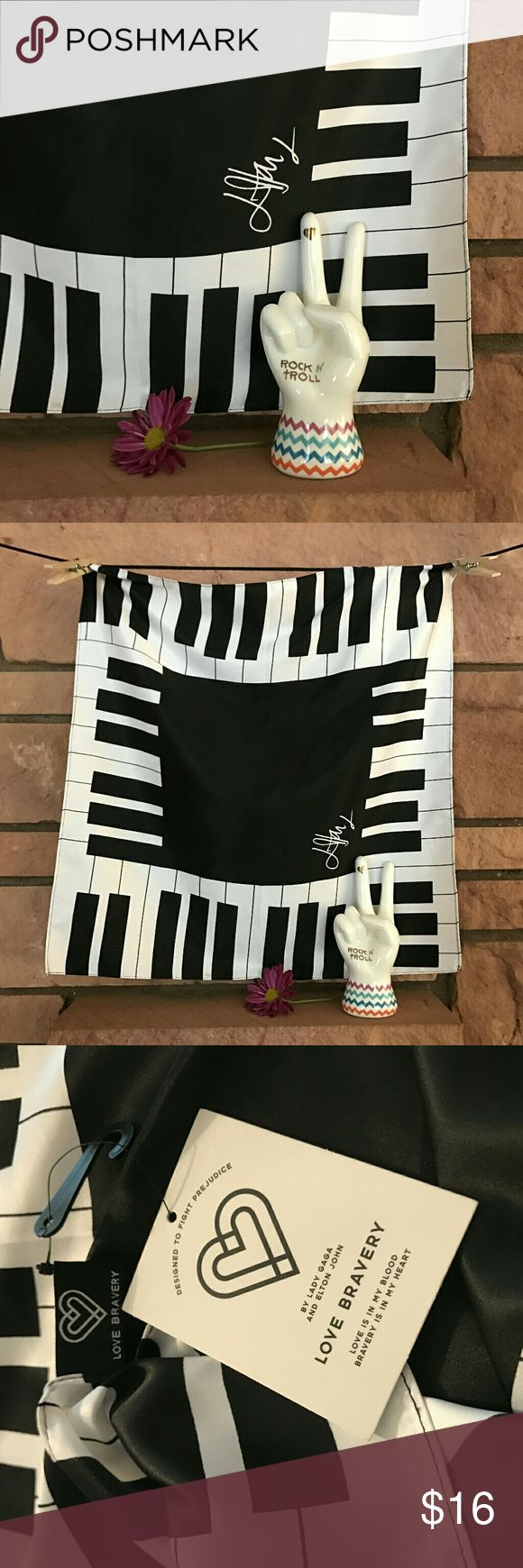 """NWT Love Bravery Piano Scarf Designed to fight prejudice, this scarf will be a great addition to your fun wardrobe!  It is a 18"""" square.   From a smoke-free and happy-to-bundle closet.   The peace hand jewelry holder is available as a free gift with purchase of a bundle of three or more Betsey Johnson Trolls and Love Bravery items.  No trades or transactions outside of Poshmark.  [N175] Love Bravery Accessories Scarves & Wraps"""