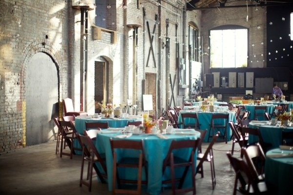 different colored tablecloths.: String Lights Blue Tablecloth, Old Buildings, Wedding Decor, Rustic Decor, Warehouses Wedding Receptions, Basilica Hudson, Bright Colors, Wedding Venues, Colors Tablecloth