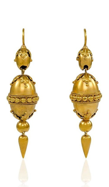 A pair of antique gold pendant earrings in the Etruscan Revival style with applied wirework and repousse detail, in 15k.          Circa:    1870