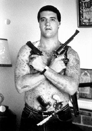 """Mark """"Chopper"""" Read was one of Australia's most notorious criminals who earned fame and fortunate by writing ten books detailing his life inside and outside of prison walls. Oh and he had his ears cut off to be transferred to another wing in prison. He died on October 9, 2013 at the age of 58."""