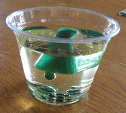 Heavy water/water cycle. Use colored ice cubes in a glass if water and see what happens when they start to melt (followed by explanation)