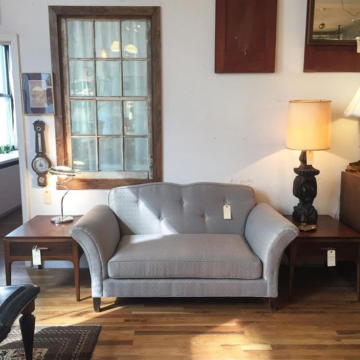 A cool blue grey loveseat paired with a couple of warm walnut side tables by Lane!