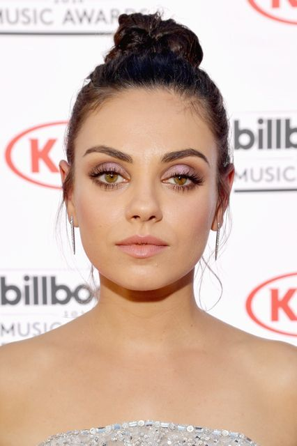 The Most Slay-Worthy Beauty Looks From The 2016 Billboard Music Awards #refinery29  http://www.refinery29.com/2016/05/111630/best-makeup-billboard-music-awards-2016#slide-10  Mila KunisIf this is what part of the Bad Moms squad looks like, then sign us up. Mila's topknot, strong brow, and shot of lilac shadow adds a new twist to boss beauty....