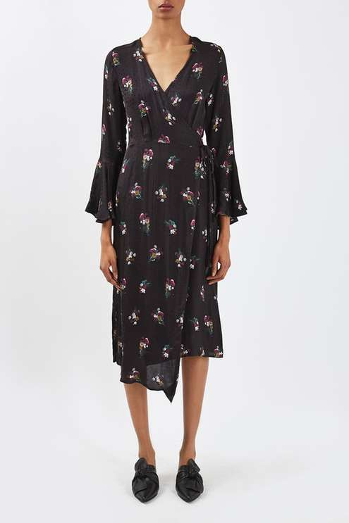 Elegant florals take centre stage in this midi dress by Boutique. In a jacquard wrap style, it features an all over bouquet pattern with pretty flared sleeves, slit detailing to the back and an uneven hemline. Wear with backless loafers to compliment the look. Made in Britain. #Topshop