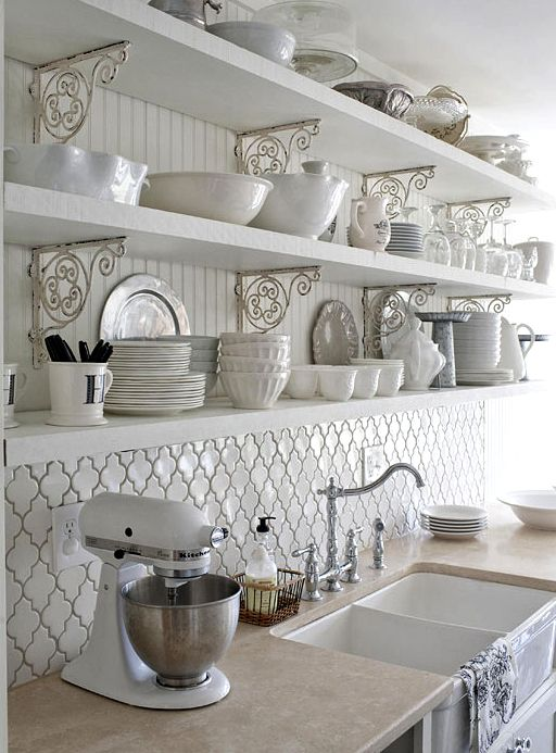 charming Country kitchen. open shelves, and love using the painted iron brackets