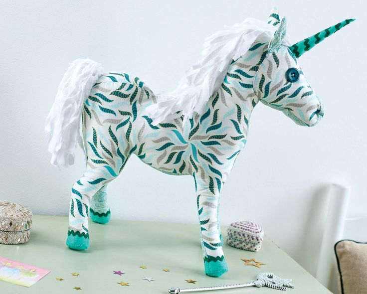 We're smitten with this mystical unicorn made from green-hued prints. Simple shapes have been stitched together and stuffed to create a sturdy yet soft finished result. With felt and ric rac hooves plus a cute horn it's the perfect plush friend to add a touch of magic to your child's room.